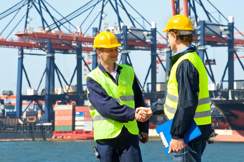 IGPL bigstock-Two-dockers-shake-hands-in-fro-26150756